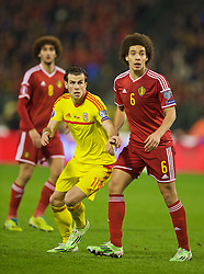 BRUSSELS, BELGIUM - Sunday, November 16, 2014: Wales' Gareth Bale and Belgium's Axel Witsel during the UEFA Euro 2016 Qualifying Group B game at the King Baudouin [Heysel] Stadium. (Pic by David Rawcliffe/Propaganda)