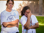 21 JUNE 2012 - PHOENIX, AZ: ROSA MARIA SOTO, (left) and GEORGINA SANCHEZ, pray in front of the State Capitol Thursday while she and other members of PAZ wait for the US Supreme Court to issue a decision in US v. Arizona. About 40 people, members of the immigrant rights' group Promise AZ (PAZ), gathered at the Capitol in Phoenix to wait for the US Supreme Court decision on SB 1070, Arizona's controversial anti-immigrant law, in the case US v. Arizona. The court's ruling is expected sometime later this month. Members of PAZ said they would continue their vigil until the ruling was issued.         PHOTO BY JACK KURTZ