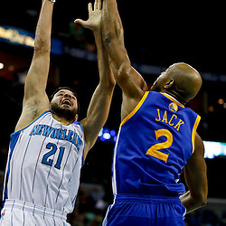Mar 18, 2013; New Orleans, LA, USA; New Orleans Hornets point guard Greivis Vasquez (21) shoots over Golden State Warriors point guard Jarrett Jack (2) during the second quarter a game at the New Orleans Arena Mandatory Credit: Derick E. Hingle-USA TODAY Sports