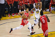 Golden State Warriors forward Kevin Durant (35) defends Houston Rockets guard Eric Gordon (10) during Game 6 of the Western Conference Finals at Oracle Arena in Oakland, Calif., on May 26, 2018. (Stan Olszewski/Special to S.F. Examiner)