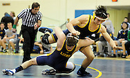 New Hope Solebury's Russell Abernathy (left) pulls Lower Moreland's Joey Chaloub to the mat during the 160 lb match Wednesday January 13, 2016 at Lower Moreland High School in Lower Moreland, Pennsylvania. (Photo by William Thomas Cain)