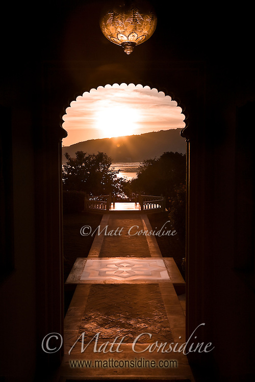 Scenic view of Udaipur's Lake Pichola at sunrise from a doorway in the Oberoi Udaivilas Palace Hotel.<br /> (Photo by Matt Considine - Images of Asia Collection)