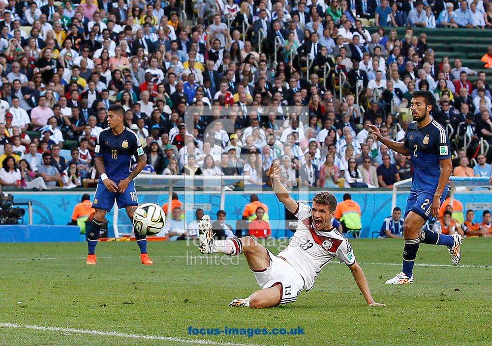 Thomas Muller of Germany sees this shot go just wide during the 2014 FIFA World Cup Final match at Maracana Stadium, Rio de Janeiro<br /> Picture by Andrew Tobin/Focus Images Ltd +44 7710 761829<br /> 13/07/2014
