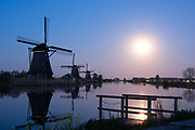 18th century windmills at Kinderdijk village, South Holland province in the Netherlands. The old windmill watermanagement system controls fooding in the dutch polder area. Iconic UNESCO World Heritage.