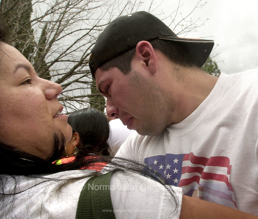 "Isaac Osuna, 20, cries after witnessing counter protestors burn the flag of Mexico at a protest of immigration legislation attended by about 15,000 on April 10, 2006, at Armory Park in Tucson, Arizona.  Counter protestors chanted, ""Viva Zapata....Return home and fight for your rights.....Respect your own revolution tradition."" They also said, ""You people have been betrayed by communism.""  Protestors of immigration legislation responded with, ""Si se puede,"" and ""We didn't cross the border, the border crossed us."""
