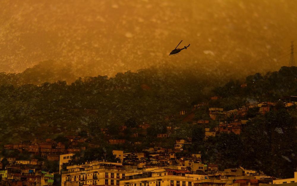 Rio de Janeiro's slum kept under surveillance by police helicopter.