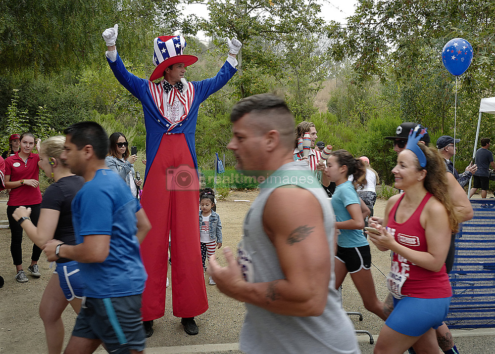 July 4, 2017 - Laguna Niguel, CA - California, USA - United States - Uncle Sam cheers on runners during the start of the 39th Annual Fourth of July Run for Fun Tuesday, July 4, 2017 in Laguna Niguel. (Credit Image: © Michael Fernandez Mike Fernandez/The Orange County Register via ZUMA Wire)