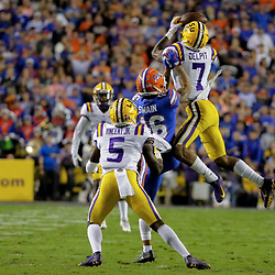 Oct 12, 2019; Baton Rouge, LA, USA; LSU Tigers safety Grant Delpit (7) breaks up a pass intended for Florida Gators wide receiver Freddie Swain (16) during the first half at Tiger Stadium. Mandatory Credit: Derick E. Hingle-USA TODAY Sports