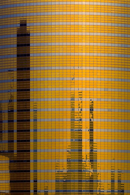 A skyscraper on the Bund in Shanghai reflects its surroundings to resemble a microprocessor.