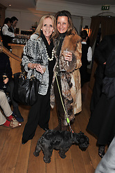 Left to right, GILLY GRANT and CINDY LASS and their dog Flash at the launch of George's Dinner for Dogs menu in aid of The Dog's Trust held at George, 87-88 Mount Street, London on 19th March 2013.