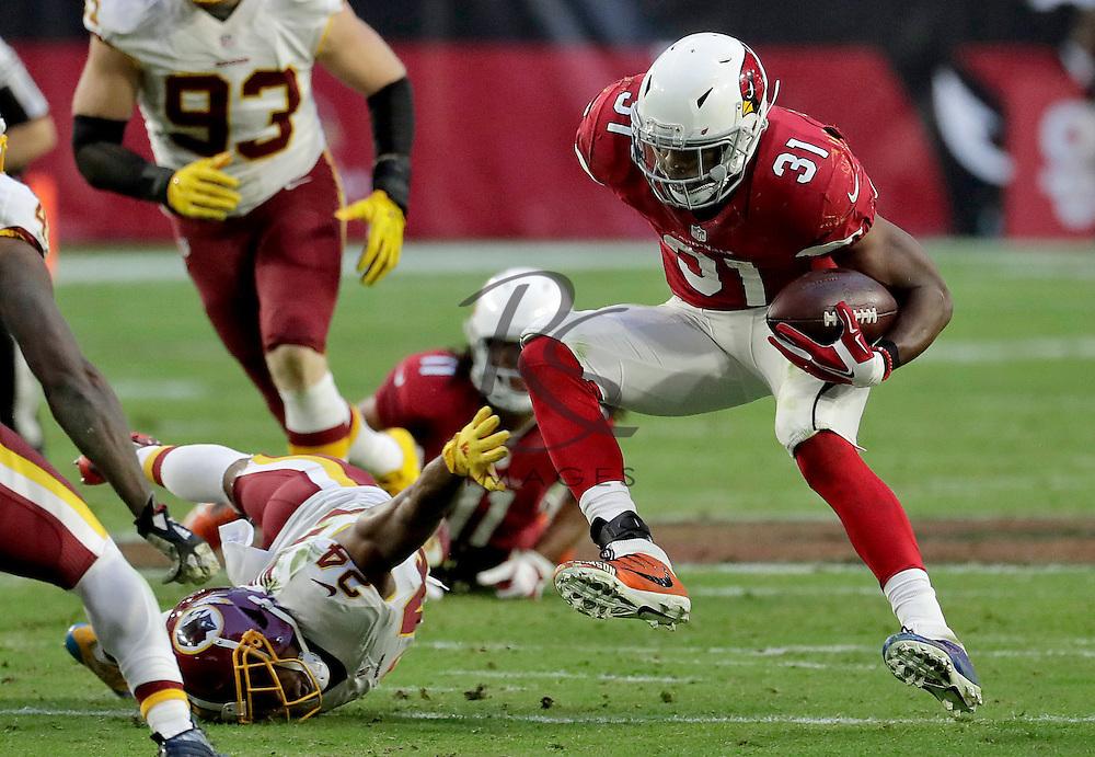 Arizona Cardinals running back David Johnson (31) eludes the reach of Washington Redskins cornerback Josh Norman (24) during the second half of an NFL football game, Sunday, Dec. 4, 2016, in Glendale, Ariz. (AP Photo/Rick Scuteri)