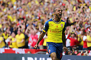 Arsenal's Theo Walcott opens the scoring and celebrates during the The FA Cup match between Arsenal and Aston Villa at Wembley Stadium, London, England on 30 May 2015. Photo by Phil Duncan.