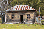 Dilapidated rundown old wooden farm house in paddock near Dunedoo, New South Wales, Australia