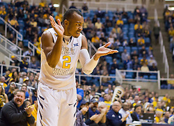 West Virginia Mountaineers guard Jevon Carter (2) celebrates after a turnover against the Wofford terriers during the first half at the WVU Coliseum.