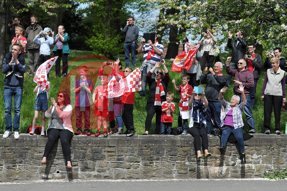Bristol City fans wave as the Bristol City celebration tour bus goes past - Photo mandatory by-line: Dougie Allward/JMP - Mobile: 07966 386802 - 04/05/2015 - SPORT - Football - Bristol -  - Bristol City Celebration Tour