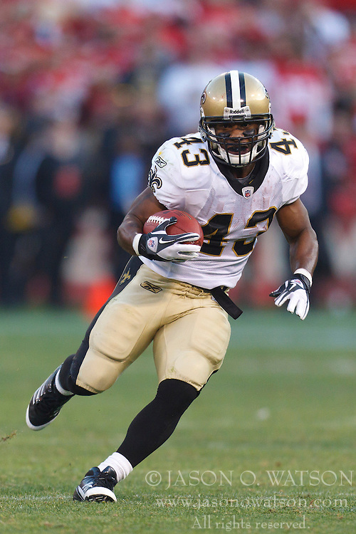 Jan 14, 2012; San Francisco, CA, USA; New Orleans Saints running back Darren Sproles (43) rushes up field for a touchdown against the San Francisco 49ers during the fourth quarter of the 2011 NFC divisional playoff game at Candlestick Park. San Francisco defeated New Orleans 36-32. Mandatory Credit: Jason O. Watson-US PRESSWIRE