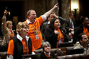 Wisconsin Democratic Rep. Andy Jorgensen, center, and other Democrats protest as Republican representatives manuever to quickly pass a bill to eliminate collective bargaining at the State Capitol in Madison, Wisconsin, February 24, 2011.