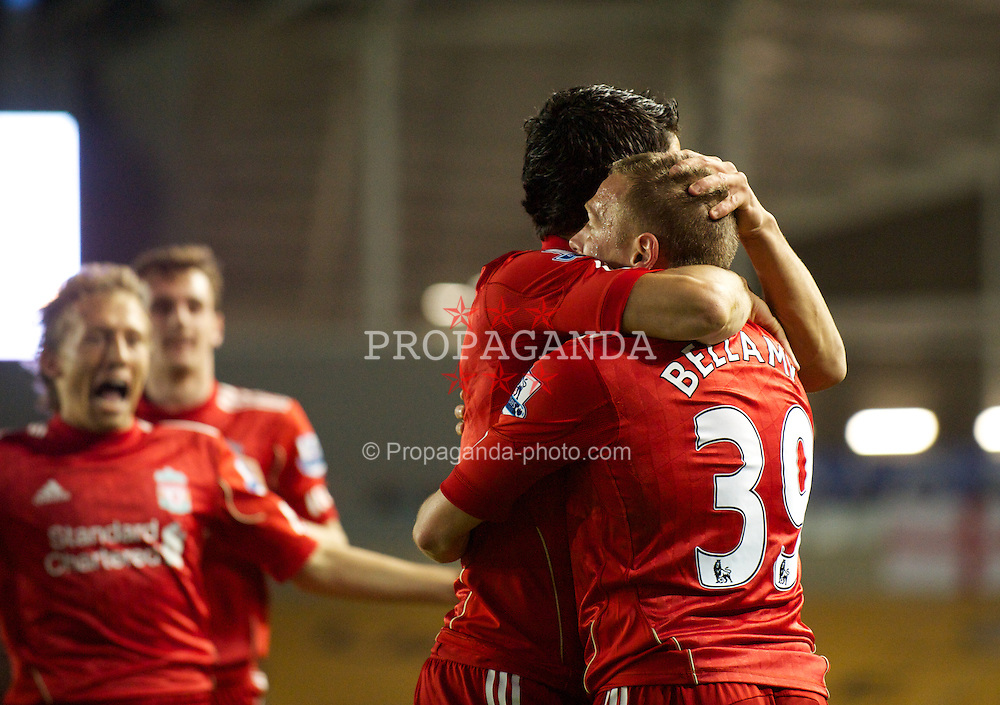 BRIGHTON, ENGLAND - Wednesday, September 21, 2011: Liverpool's Craig Bellamy celebrates scoring the first goal against Brighton & Hove Albion with team-mate Luis Alberto Suarez Diaz during the Football League Cup 3rd Round match at the Amex Stadium. (Pic by David Rawcliffe/Propaganda)