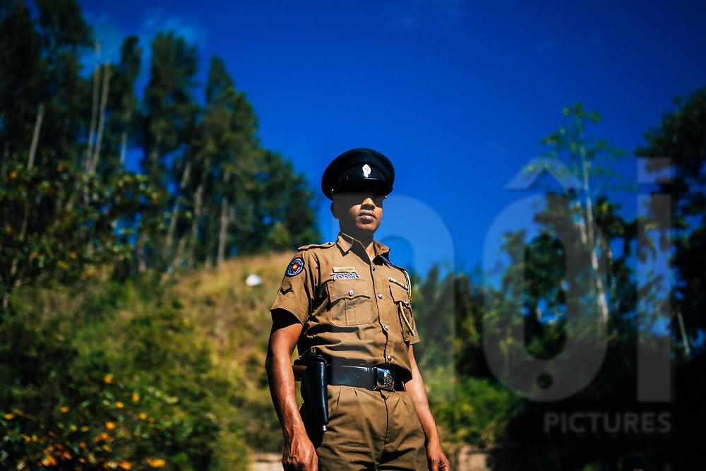 Portrait of a railway officer near Nine Arches Bridge, Ella, Sri Lanka, Asia