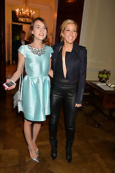 Left to right, ELLA CATLIFF and ELLIE GOULDING at a party hosed by the US Ambassador to the UK Matthew Barzun, his wife Brooke Barzun and editor of UK Vogue Alexandra Shulman in association with J Crew to celebrate London Fashion Week held at Winfield House, Regent's Park, London on 16th September 2014.