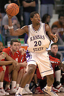 Kansas State forward Cartier Martin looks to make a pass against Nebraska in the first half.  The Huskers defeated K-State 57-42 at Bramlage Coliseum in Manhattan, Kansas, January 11, 2006.