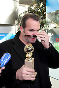 17.JANUARY.2012. PARIS<br /> <br /> JEAN DUJARDIN WITH HIS WIFE ALEXANDRA LAMY AND LUDOVIC BOURCE ARRIVE AT ROISSY CHARLES DE GAULLE IN FRANCE. JEAN DUJARDIN WON THE GOLDEN GLOBE FOR THE BEST COMEDY ACTOR FOR HIS PERFORMANCE IN THE MOVIE, &quot;THE ARTIST&quot;<br /> <br /> BYLINE: EDBIMAGEARCHIVE.COM<br /> <br /> *THIS IMAGE IS STRICTLY FOR UK NEWSPAPERS AND MAGAZINES ONLY*<br /> *FOR WORLD WIDE SALES AND WEB USE PLEASE CONTACT EDBIMAGEARCHIVE - 0208 954 5968*