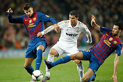 25.01.2012, Stadion Camp Nou, Barcelona, ESP, Copa del Rey, FC Barcelona vs Real Madrid, im Bild Barcelona's Gerard Pique\ and Busquets and Real Madrid's Ronaldo // during the football match of spanish Copy del Rey, between FC Barcelona and Real Madrid at Camp Nou stadium, Barcelona, Spain on 2012/01/25. EXPA Pictures © 2012, PhotoCredit: EXPA/ Alterphotos/ Cesar Cebolla..***** ATTENTION - OUT OF ESP and SUI *****