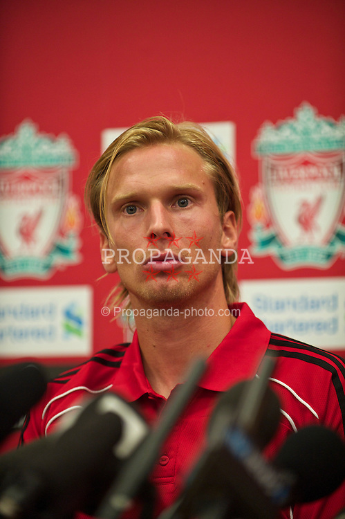 LIVERPOOL, ENGLAND - Friday, August 13, 2010: Liverpool's new signing Christian Poulsen at a press conference at the club's Melwood Training Ground. The 30-year-old Danish international midfielder Poulsen joins the Reds from Italian side Juventus on a three-year deal. (Pic by: David Rawcliffe/Propaganda)