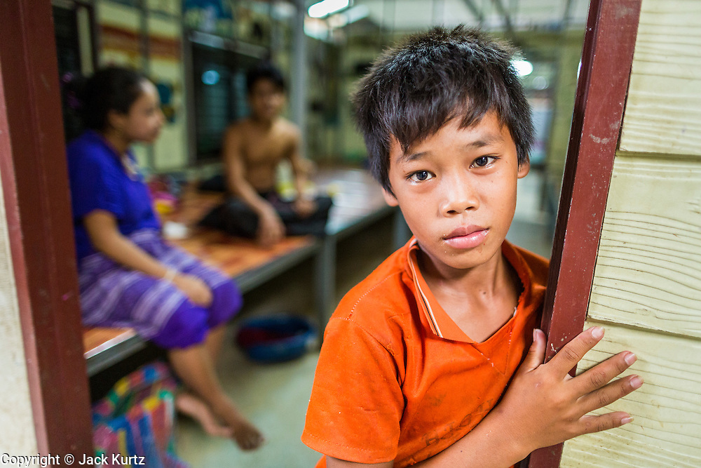 20 MAY 2013 - MAE KASA, TAK, THAILAND:  A Burmese boy in front of his ward at the SMRU clinic in Mae Kasa, Thailand. Health professionals are seeing increasing evidence of malaria resistant to artemisinin coming out of the jungles of Southeast Asia. Artemisinin has been the first choice for battling malaria in Southeast Asia for 20 years. In recent years though,  health care workers in Cambodia and Myanmar (Burma) are seeing signs that the malaria parasite is becoming resistant to artemisinin. Scientists who study malaria are concerned that history could repeat itself because chloroquine, an effective malaria treatment until the 1990s, first lost its effectiveness in Cambodia and Burma before spreading to Africa, which led to a spike in deaths there. Doctors at the Shaklo Malaria Research Unit (SMRU), which studies malaria along the Thai Burma border, are worried that artemisinin resistance is growing at a rapid pace. Dr. Aung Pyae Phyo, a Burmese physician at a SMRU clinic just a few meters from the Burmese border, said that in 2009, 90 percent of patients were cured with artemisinin, but in 2010, it dropped to about 70 percent and is now between 55 and 60 percent. He said the concern is that as it becomes more difficult to clear the parasite from a patient, progress that has been made in combating malaria will be lost and the disease could make a comeback in Southeast Asia.    PHOTO BY JACK KURTZ