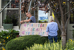 """© Licensed to London News Pictures. 04/08/2019. Whaley Bridge, UK. A placard reading """" Thank you for all your help!"""" is tied up outside a house by residents living just outside the cordon , in thanks to emergency services . Further homes have been evacuated overnight and more rain is forecast today (Sunday 4th August) in the town of Whaley Bridge in Derbyshire after earlier heavy rain caused damage to the Toddbrook Reservoir , threatening homes and businesses with flooding. Photo credit: Joel Goodman/LNP"""