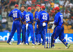 September 20, 2018 - Abu Dhabi, United Arab Emirates - Afghanistan cricketer Gulbadin Naib celebrates with team mates  after taking a wicket during the 6th cricket match of Asia Cup 2018 between Bangladesh and Afghanistan at the Sheikh Zayed Stadium,Abu Dhabi, United Arab Emirates on September 20, 2018. (Credit Image: © Tharaka Basnayaka/NurPhoto/ZUMA Press)