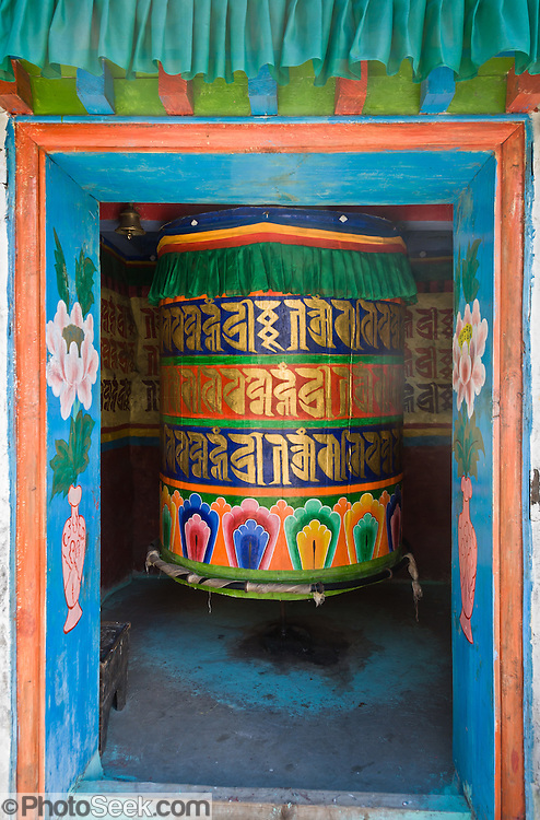 A Mani Thungkyur, a large prayer wheel containing religious books, is along the trail from Lukla to Namche Bazaar in Sagarmatha National Park, Nepal, Asia. Sagarmatha National Park was created in 1976 and honored as a UNESCO World Heritage Site in 1979.