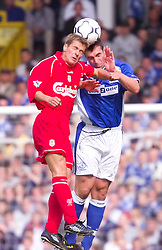 LIVERPOOL, ENGLAND - Saturday, September 15, 2001: Liverpool's Michael Owen and Everton's David Unsworth during the Premiership match at Goodison Park. (Pic by David Rawcliffe/Propaganda)