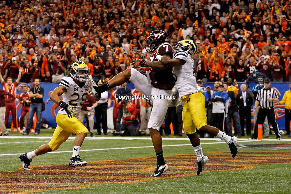 January 3, 2012; New Orleans, LA, USA; Virginia Tech Hokies wide receiver Marcus Davis (7) catches a two point conversion over Michigan Wolverines defensive back Blake Countess (18) during the fourth quarter of the Sugar Bowl at the Mercedes-Benz Superdome.  Mandatory Credit: Derick E. Hingle-US PRESSWIRE
