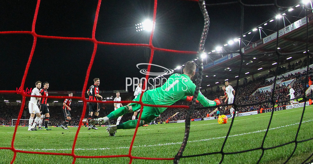 David De Gea of Manchester United makes a save during the Barclays Premier League match between Bournemouth and Manchester United at the Goldsands Stadium, Bournemouth, England on 12 December 2015. Photo by Phil Duncan.