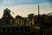 "4th February 2016, New Delhi, India. View of the ruins of Feroz Shah Kotla in New Delhi, India on the 4th February 2016<br /> <br /> PHOTOGRAPH BY AND COPYRIGHT OF SIMON DE TREY-WHITE a photographer in delhi<br /> + 91 98103 99809. Email: simon@simondetreywhite.com<br /> <br /> People have been coming to Firoz Shah Kotla to pray to and leave written notes and offerings for Djinns in the hopes of getting wishes granted since the late 1970's. Jinn, jann or djinn are supernatural creatures in Islamic mythology as well as pre-Islamic Arabian mythology. They are mentioned frequently in the Quran  and other Islamic texts and inhabit an unseen world called Djinnestan. In Islamic theology jinn are said to be creatures with free will, made from smokeless fire by Allah as humans were made of clay, among other things. According to the Quran, jinn have free will, and Iblīs abused this freedom in front of Allah by refusing to bow to Adam when Allah ordered angels and jinn to do so. For disobeying Allah, Iblīs was expelled from Paradise and called ""Shayṭān"" (Satan).They are usually invisible to humans, but humans do appear clearly to jinn, as they can possess them. Like humans, jinn will also be judged on the Day of Judgment and will be sent to Paradise or Hell according to their deeds. Feroz Shah Tughlaq (r. 1351–88), the Sultan of Delhi, established the fortified city of Ferozabad in 1354, as the new capital of the Delhi Sultanate, and included in it the site of the present Feroz Shah Kotla. Kotla literally means fortress or citadel."