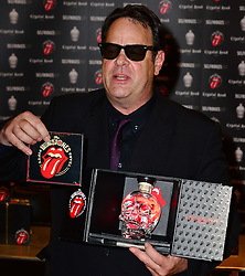 Dan Aykroyd signing. Canadian-American actor and comedian signs bottles of his Crystal Head Vodka at Selfridges's newly relaunched Wine Shop. The vodka brand has teamed up with The Rolling Stones to create a limited edition 40th anniversary gift set. Selfridges, Oxford Street, London, United Kingdom, May 14, 2013. Photo by: Nils Jorgensen / i-Images