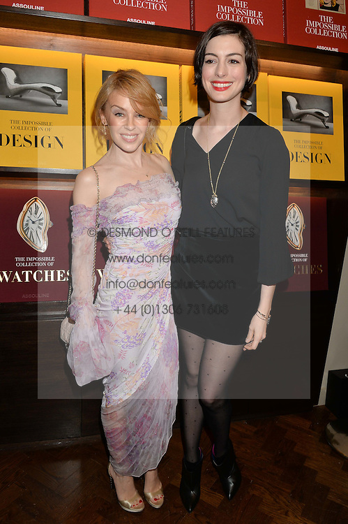Left to right, KYLIE MINOGUE and ANNE HATHAWAY  at a party to celebrate the launch of the Maison Assouline Flagship Store at 196a Piccadilly, London on 28th October 2014.  During the evening Valentino signed copies of his new book - At The Emperor's Table.
