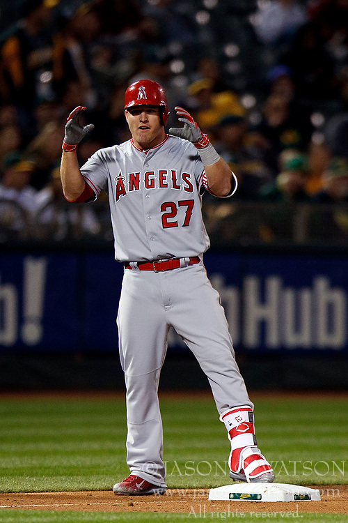 OAKLAND, CA - APRIL 04:  Mike Trout #27 of the Los Angeles Angels of Anaheim celebrates after hitting an RBI triple against the Oakland Athletics during the fifth inning at the Oakland Coliseum on April 4, 2017 in Oakland, California. The Los Angeles Angels of Anaheim defeated the Oakland Athletics 7-6. (Photo by Jason O. Watson/Getty Images) *** Local Caption *** Mike Trout