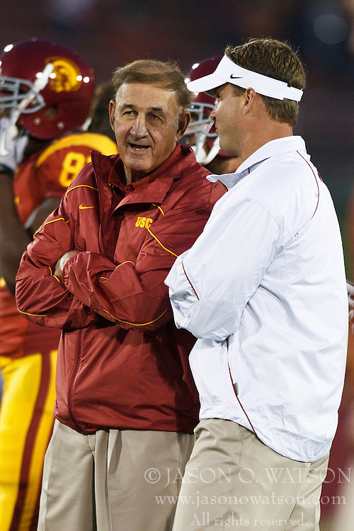September 11, 2010; Los Angeles, CA, USA;  Southern California Trojans head coach Lane Kiffin (right) talks to defensive coordinator Monte Kiffin (left) before the gamer at the Los Angeles Memorial Coliseum. USC defeated Virginia 17-14.