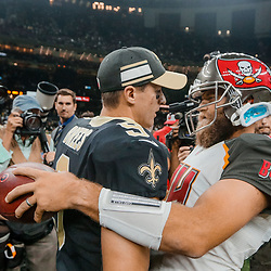 Sep 9, 2018; New Orleans, LA, USA; New Orleans Saints quarterback Drew Brees (9) and Tampa Bay Buccaneers quarterback Ryan Fitzpatrick (14) talk following a game at the Mercedes-Benz Superdome. The Buccaneers defeated the Saints 48-40. Mandatory Credit: Derick E. Hingle-USA TODAY Sports