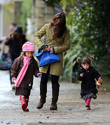 TV presenter Myleene Klass wearing a pair of mirror tinted shades, green coat and brown knee high boots, picking up her daughters Hero and Ava from school. London, UK. 28/01/2013<br />BYLINE MUST READ : GOTCHAIMAGES.COM<br /><br />Copyright by © Gotcha Images Ltd. All rights reserved.<br />Usage of this image is conditional upon the acceptance <br />of Gotcha Images Ltd, terms and conditions available at<br />www.gotchaimages.com