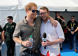 Prince Harry (left) chats with former competitor and now commentator JJ Chalmers outside the competitor's tent at the swimming pool during the Invictus Games 2016 at ESPN Wide World of Sports in Orlando, Florida.