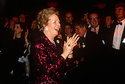 Looking happy but within a few months of being deposed after a leadership challenge, Prime Minister Margaret Thatcher applauds supporters at the Conservative party conference on 10th October 1990 in Blackpool, England.