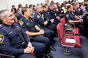 06 FEBRUARY 2012 - PHOENIX, AZ:    Arizona police commanders and chiefs in the State Senate hearing room prepare to speak out against loosening Arizona gun laws on Monday, Feb. 6. The Arizona State Senate's Judiciary Committee, chaired by Sen Ron Gould (Republican) debated several bills Monday that would loosen the state's gun laws, already among the loosest in the United States. One bill would allow anyone with a concealed carry permit to carry guns on the grounds of public universities. Universities could only ban guns if they provided secured gun lock boxes in each building. Universities, which are opposed to the legislation, say that the lock boxes would cost hundreds of thousands of dollars and that guns would make the campuses less safe. Most of the police departments in Arizona, as well as university student bodies, also oppose the legislation to allow guns on campus.   PHOTO BY JACK KURTZ