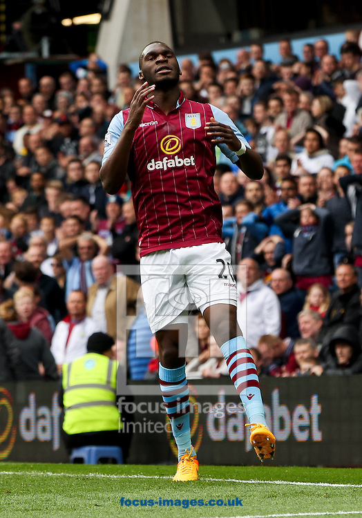 Christian Benteke of Aston Villa reacts to missing the target with his shot during the Barclays Premier League match at Villa Park, Birmingham<br /> Picture by Tom Smith/Focus Images Ltd 07545141164<br /> 09/05/2015