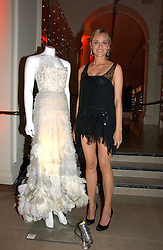 Actress DIANE KRUGER standing next to the dress that she wore at the Premier of Troy in Cannes 2004 at the 5th anniversary party for InStyle magazine held at The V&A, Cromwell Road, London SW7 on 19th June 2006.<br />