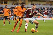 Burnley defender Scott Arfield and Wolverhampton Wanderers defender Dominic Iorfa in action during the Sky Bet Championship match between Wolverhampton Wanderers and Burnley at Molineux, Wolverhampton, England on 7 November 2015. Photo by Alan Franklin.