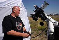 Rick Roty works with his telescope in a designated eclipse viewing area in a campground near Guernsey, Wyoming U.S. August 20, 2017.  REUTERS/Rick Wilking