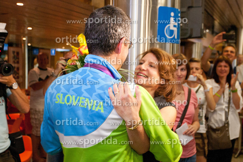 Rajmond Debevec with his wife Metka during reception of Slovenian Olympic team, on August 7, 2012 in Airport Joze Pucnik, Brnik, Slovenia.  (Photo by Matic Klansek Velej / Sportida)